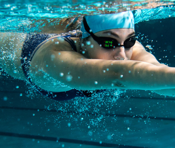 Woman swimming with goggles